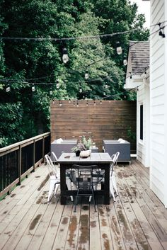 Happy official first day of Summer! It has been nothing but swimming, adventuring, napping & evening thunderstorms over here. Isn't that what Summer is all about?! I wanted to share a little tutorial on how we hung our string lights on the back deck. Tons of you have asked about how to do it, as this is a super common deck set up where there isn't something on the opposite end of the house to attach your lights to! My husband, a master problem solving extraordinaire, put this set up toget...