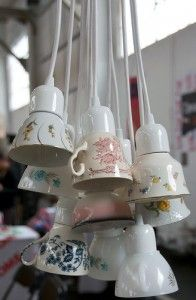 I would love to do this with all the Fiestaware teacups I have...awesome over the kitchen sink!