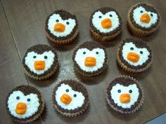 Penguin cupcakes--1/4 of a candy orange wedge makes a great beak
