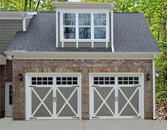 Yes, you can paint your garage door to match your exterior paint color scheme. We love the sage green against this red brick. Doors shown: Clopay Coachman Collection carriage house garage doors. Timber Garage Door, Carriage House Garage Doors, Modern Garage Doors, Garage House, Steel Garage, Garage Door Colors, Garage Door Styles, Garage Door Design, Best Exterior Paint