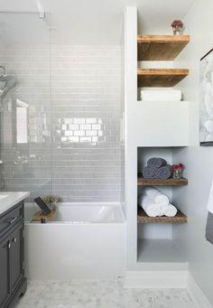 Bathroom, white subway tile, mosaic floor tile, glass shower tub, wood shelving / Carriage Lane Design-Build Inc. Upstairs Bathrooms, Basement Bathroom, Bathroom Shelves, Master Bathroom, Bathroom Storage, Small Bathrooms, Modern Bathroom, Master Tub, Small Bathroom Layout