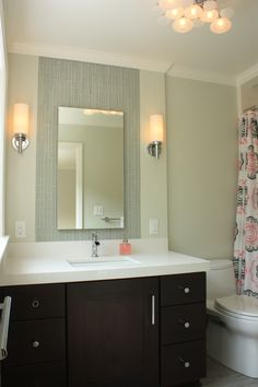 This bathroom was redesigned to suit the homeowners' toddler as she grows. Doorways and hallway space were reconfigured for a more functional layout. Fun elements include a bubble-massage bathtub with ambient lighting, glass & satin mosaic tile, an adjustable showerhead, a playful light fixtures, and a seven foot long chrome shower rod.  This bathroom was designed and remodeled by Matthew Krier of Design Group Three.