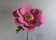 Pink Poppy Made of Felt - Pink Flower - Artificial Flower - Fake Flower - Artificial Poppy - Fake Poppy - Felt Poppy. This is a beautiful flower made of felt that lasts forever! It looks great in a vase by itself or as part of a bouquet. The stem is made of a floral wire, so it is stable but bendable. Price is for one flower. If you want another color, please check my shop. If you don't see the color you want there, please message me. I have many different colors of felt.