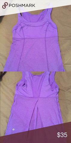 EUC Lululemon TaTa Topper tank, 4, Power Purple Lululemon Ta Ta Topper tank, in Power Purple, size 4. EUC, worn/washed once, laid flat to dry, smoke free home. Has draw cord at hem for a fitted or loose wear, depending on your preference. lululemon athletica Tops Tank Tops