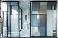 Striking glass mosaic walls separate the guest rooms from their ensuite bathrooms