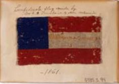 """7-star First National pattern bible flag made by Josephine (Mrs. Francis B.) Trinchard of New Orleans. The flag measures 2.75"""" x 4.75"""". Museum of the Confederacy Collection."""