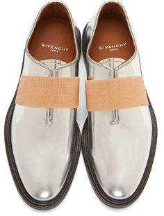 Silver Leather Loafers by Givenchy. Buffed metallic leather loafers in silver. Almond toe. Elasticised strap at vamp in beige.