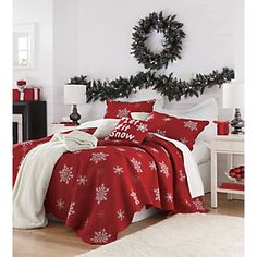 I want this SO bad ! Wish every bed in my house had Christmas bedding during the holidays...ONE DAY!! I love the wreath & garland too!