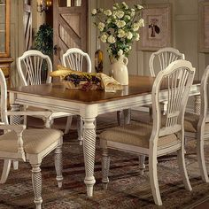 Turned dining table with arrow feet and a hand-rubbed finish.       Product: Dining table    Construction Material: