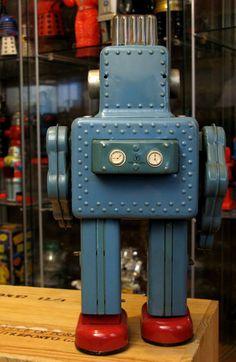 smoking spaceman tin toy robot