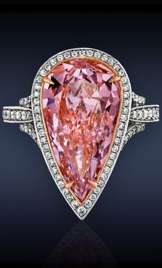 Pink Diamond Solitaire Ring by Jacob & Co. Featuring a GIA Certified 5.01 carat Very Light Pink, SI1 Pear-Shaped Diamond, highlighted with 0.60 Total Carats Pavé set Round Brilliant Cut Diamonds, Mounted in Platinum and 18K Rose Gold.