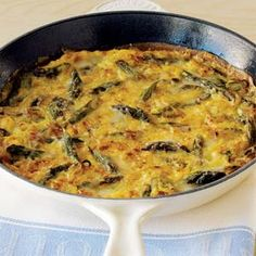 asparagus frittata. super easy to make, and you could adapt it easily for other veggies.  I like this recipe because there's no milk/cream in w/ the eggs.