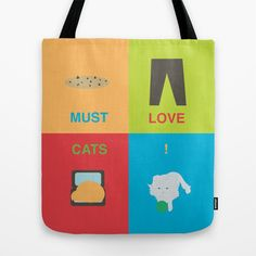You must love cats if you remove all the contents of your bag so your fur baby can take a cat nap inside! Must Love Cats Tote Bag by P.MaGeebs - $22.00
