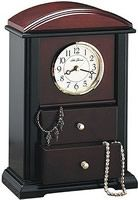 The Jewelry Box Clock by Seth Thomas is solid mahogany hardwood with a black finish. This clock has a beautiful design combined with a practical function of a jewerly box that stores jewerly within it's two velvet lined drawers.