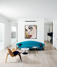They collaborated on the project with investor and landowner Holden Shannon whose own home on the Row was outfitted by designer Barbara Hill with vintage furniture like a turquoise sofa and pair of mid-century side tables from Houston's Reeves Antiques.