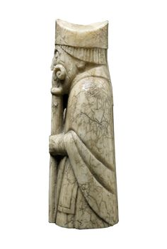 Lewis Chessmen Bishop: over his shoulders he wears a floor length cope - similar to those worn today by the clergy today. Chess Pieces, Game Pieces, Art Through The Ages, Ancient Vikings, Archaeological Finds, Viking Art, Small Sculptures, Bone Carving, Medieval Art