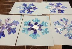 snowflake craft, we used adjectives to describe our snowflakes!