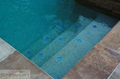 We love little details like these on the bottom of the pool. #StewartLandDesigns