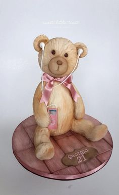 Here's a teddy bear cake I made for a girls 21st birthday, she loves music so I added an iPod :) You can view more of my cakes here: https://www.facebook.com/sweetlittletreatcakes?ref=bookmarks
