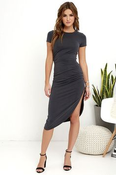 Expect wherever you wear the Capital City Charcoal Grey Midi Wrap Dress to become a fashion capital! Tantalizingly soft knit fabric shapes a crew neckline, short sleeves, and fitted bodice with chic, ruched accents. Midi-length skirt is finished with a sexy side slit to show off those legs!