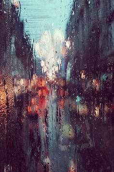 Oh, I LOVE how the photographer captured these colors!! Almost looks like an oil painting from far away... Rain on the window pane, looking out of the hospital or a car.. It doesn't matter the rain was one thing that calmed all the patients....