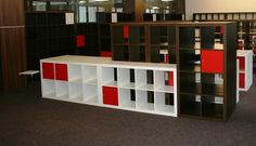 ideation - low credenza for brick wall, back painted sections in corporate colours