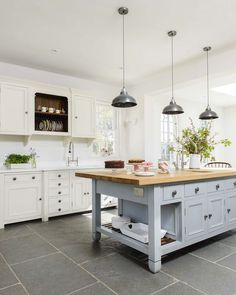 Slate floors. Miranda Gore Browne's Chalon Modern Country kitchen. Click through for all the details!