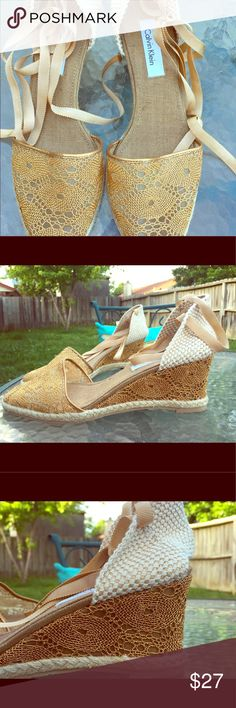 Calvin Klein Gold Wedge Lace Up Espadrilles. Calvin Klein Gold Wedge Espadrilles. Ribbon lace up. Lots of beautiful detail on these shoes. Perfect with a summery dress or a pair of jeans or cutoffs. Size 8. Brand new condition. Calvin Klein Shoes Wedges