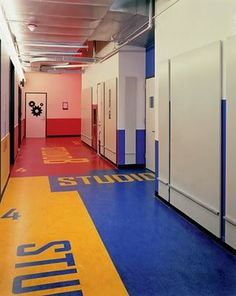 Interesting idea: keep walls neutral but use floor for wayfinding.  {environmental graphics - Paula Scher}