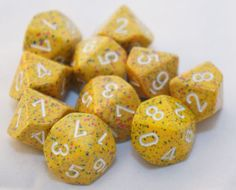 10-Piece-Set-Yellow-w-Pink-Blue-Speckle-Ten-Sided-Dice-Chessex-Vampire-D10 This is not a set that they have sold. These are randoms from a pound of dice. I love them though. Wish I could get a 7pc polyhedral set.