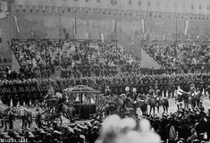 The carriage of the tsarina passes by the temporary grandstands set up on the Red Square, on the place of the later Lenin Mausoleum