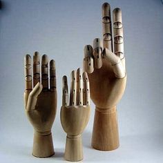 Wooden Mannequin Display Hands. I have finally threatened my sons that if they make these flip the bird just one more time, I'll ground them all.