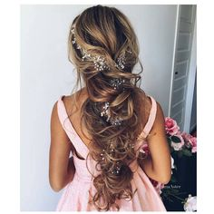 """Intricate """"messy"""" up-do with flowers."""