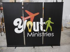 Texas District United Pentecostal Church International Youth uses three banner stands (that retract to fit into small cases) to align side by side to create a banner wall.