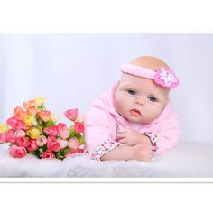 Meet London, the sweet infant baby girl with stunning blue eyes Beautifully dressed in her pink hoodie and pants 20 inches from head to toe, with quality vinyl head and limbs She feels like an infant