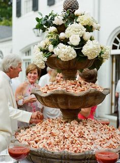 What could be more perfect on a warm summer day than an endless fountain of chilled shrimp cocktail with all the fixings?   Brides.com