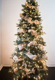 a ribbon is the perfect solution to concealing those bare spots in your christmas tree while