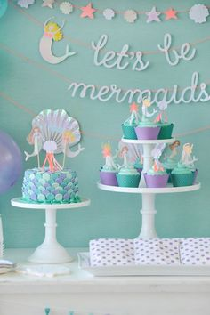 Mermaid themed birthday party dessert table. Mermaid tail inspired cake and cupcakes. Mermaid Party styling by Happy Wish Company. Photography by Tammy Hughes Photography. Stationery by Minted artist, Bonjour Paper.