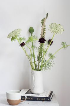 Tall green wildflowers in a white vase.  What a wonderful vignette! {by avenuelifestyle.com}