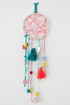 Little kids will love choosing different beads, yarn and other elements for this easy dream catcher  inspired craft at Little Hip Squeaks.