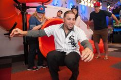 Hector Santiago #53 of the Chicago White Sox goes down the Home Run Slide during a visit to the MLB Fan Cave Wednesday, September 4, 2013, at Broadway and 4th Street in New York City. (Photo by Thomas Levinson/MLB Photos via Getty Images)