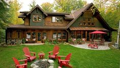 Love the rustic look to this Lakeside home & the pops of red at the firepit, patio & swing