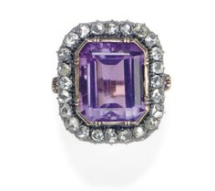 AN ANTIQUE AMETHYST, DIAMOND AND GOLD RING   1 rectangular-cut amethyst, weighing approximately 8.00-9.00 carats, pinkish purple, of moderate to strong saturation, numerous rose-cut diamonds, nice life and brilliance, circa 1890