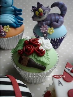 Alice in Wonderland 3rd Edition - painting the roses red by Darcy's Cupcake Creations, via Flickr
