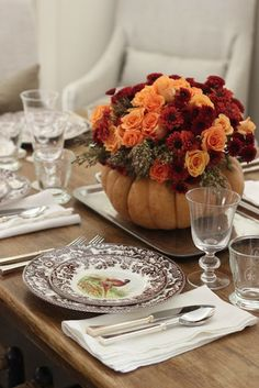 Use seasonal autumn flowers such as broom cob, roses, and mums to fill your DIY pumpkin vase, perfect for Thanksgiving tablescape. Diy Thanksgiving Centerpieces, Fall Table Centerpieces, Thanksgiving Table Settings, Centerpiece Ideas, Thanksgiving Diy, Fall Decorations, Thanksgiving Flowers, Thanksgiving Tablescapes, Table Arrangements