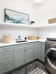 Designing and decorating a laundry room can be lots of fun. It is one of those areas of a home that is normally not that big but can be very stylish. Many hours are spent in a laundry room, so shouldn't it be an aesthetically pleasing space? Laundry Room Colors, Laundry Room Tile, Grey Laundry Rooms, Laundry Room Remodel, Laundry Room Cabinets, Farmhouse Laundry Room, Room Tiles, Laundry Room Design, Design Kitchen