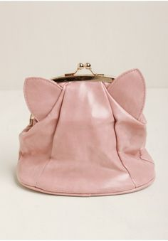 Create a chic vintage-inspired look with this silky-smooth pink bag featuring a gold-toned snap-lock closure at the top and an adorable cat ear-inspired design. Style it as a clutch for a night...