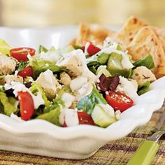 Herbed Greek Chicken Salad    Greek seasoning―as simple as oregano and lemon―pairs fantastically with chicken and forms the base for this fresh and healthful salad. Yogurt and tahini make a creamy dressing, while kalamata olives and feta cheese add their own distinctly Greek flavors to the party. Each large, satisfying serving has only 243 calories.