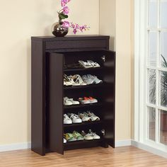 $188.99 - Overstock - With five shelves and easy opening doors, this cocoa shoe cabinet has space for fifteen pairs of shoes. The cabinet also features a drawer for even more storage. You will be able to store your shoes and add style to your room with this wooden cabinet.http://www.overstock.com/Home-Garden/Studio-5-shelf-Red-Cocoa-Shoe-Cabinet/5328390/product.html?CID=214117 $188.99