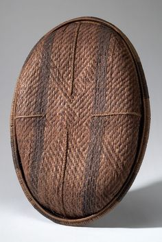 BASKET/LID AFRICAN ETHNOGRAPHIC COLLECTION Catalog No: 90.0/ 705 AB Field No: 433 Culture: LOZI? (BAROTSE?) Locale: BAROTSELAND, LEALUI Country: ZAMBIA? Material: PLANT FIBER, DYE Dimensions: A) L:67.5 W:44.5 H:9.5 B) L:71.3 W:49 H:7 [in CM] Acquisition Year: 1907 [PURCHASE] Donor: DOUGLAS, RICHARD